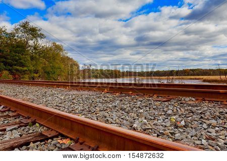 Railroad blue sky and cloudy sky clouds railroad