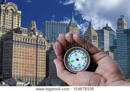 Navigating in New York City with a compass in hand.