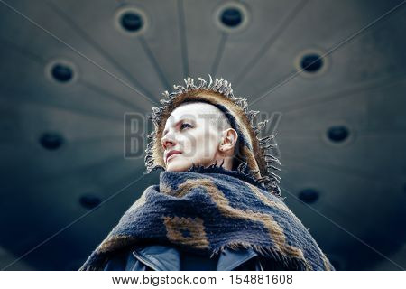 Closeup portrait of beautiful Caucasian white young bald girl woman with shaved hair head in leather jacket and scarf shawl looking away spiritual mood state of mind conceptual art