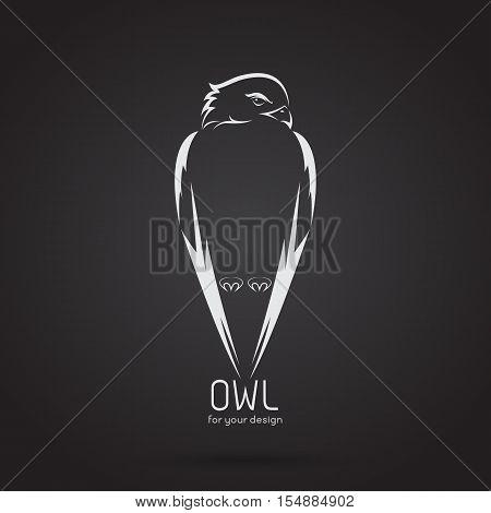 Vector image of a owl design on black background Vector owl logo. Wild Animals.