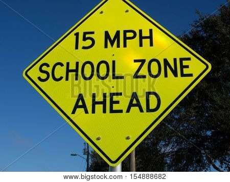 15 MPH School Speed Limit Warning Sign in a residential area in Lake Wales Florida