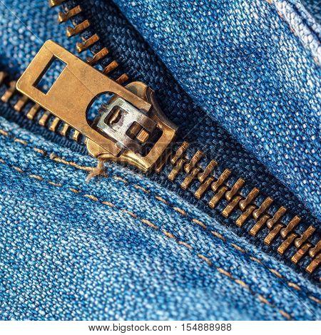 Denim jeans texture or denim jeans background with zipper. Old grunge vintage denim jeans. Stitched texture denim jeans background of fashion jeans design.