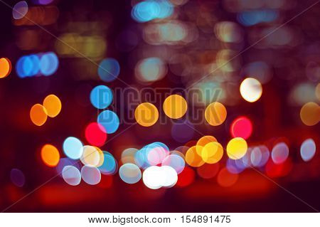 Abstract colorful blurry background bokeh cold and warm colors tone pink violet pirple yellow red colors cinematic effect evening night street romantic lights