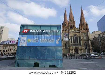 MELBOURNE, AUSTRALIA - JANUARY 25, 2016: Melbourne Visitor Centre and St. Paul's Cathedral in Downtown Melbourne