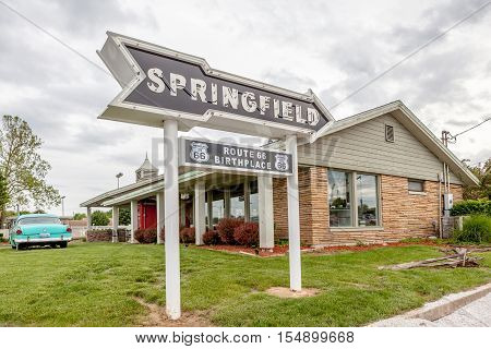 Springfiled Missouri USA- May 18 2014. Springfield road arrow sign with cafe background in best western route 66 rail haven.