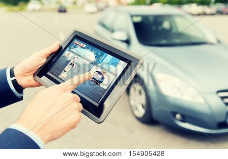 transport, business trip, mass media, technology and people concept - close up of male hands with news on tablet pc computer screen and car outdoors