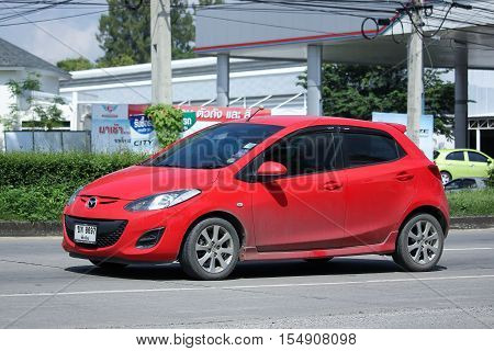 CHIANGMAI THAILAND - OCTOBER 9 2016: Private car Mazda 2. On road no.1001 8 km from Chiangmai Business Area.