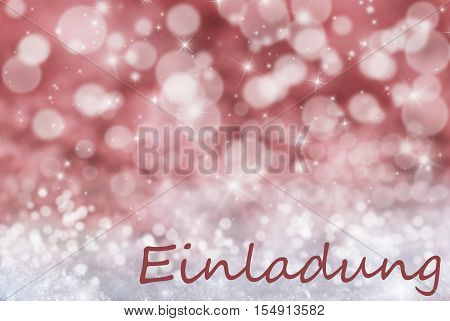 German Text Einladung Means Invitation. Sparkling Red Bokeh Christmas Background Or Texture With Snow And Stars. Copy Space For Your Text Here