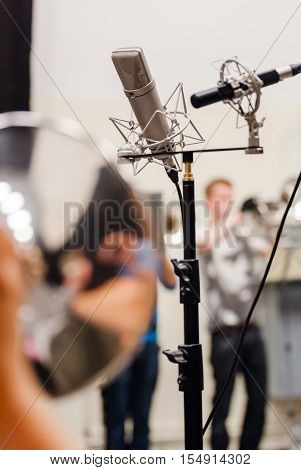 Sound recording in the studio with details or playing musicians instruments in a marching band or music show band