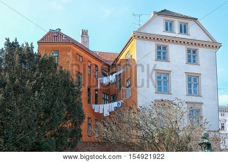 COPENHAGEN, DENMARK - APRIL 13, 2010: Laundry drying on a rope stretched between two houses. Not far from St Ann Square and Garrison Church