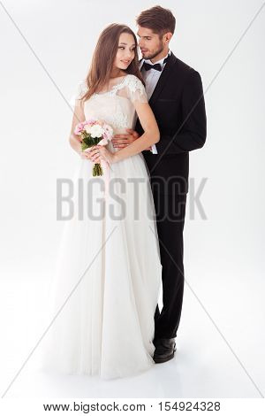 Full-length portrait of newlyweds. isolated white background