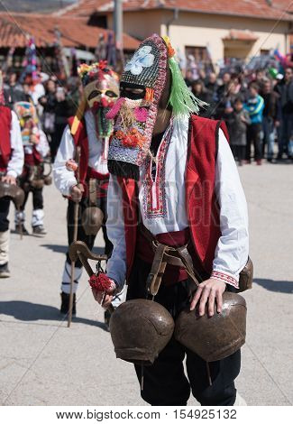 Paisievo, Bulgaria - March 26, 2016: People in costumes are taking part in the festival of Mummers in Paisievo, Bulgaria. People dressed in different costumes dance and preform rituals to scare the evil spirits
