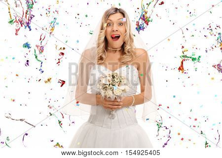 Overjoyed young bride holding a bouquet with confetti streamers around her isolated on white background