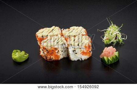 Delicious Sushi set. Uramaki sushi rolls decorated with Japanese mayonnaise and caviar