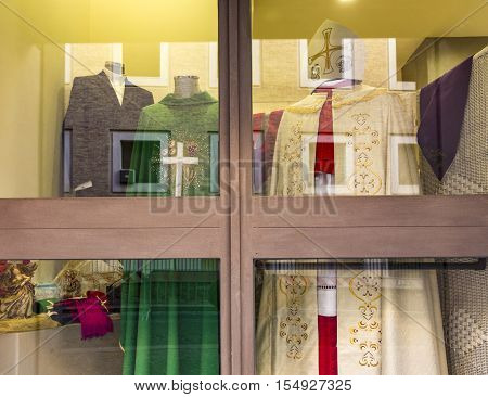 VATICAN CITY VATICAN - DEC 23 2015: liturgical garments in a shop window in Vatican city for catholic priests.
