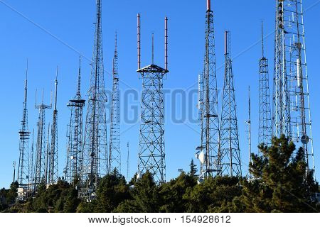 Cluster of antennas transporting airwave signals for television and radio taken in Mt Wilson, CA