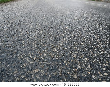 Picture of the asphalt road close up. Background of the grey stone road. Asphalt texture pattern close up.
