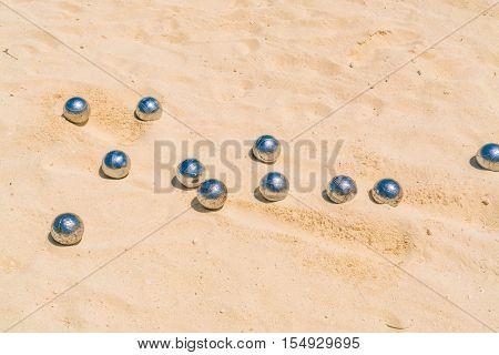 Bocce balls on white sandy beach