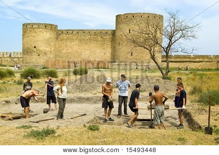 The young people help the archeologist. Fortress Ackerman, city Belgorod-Dnestrovskiy, Ukraine, Europe