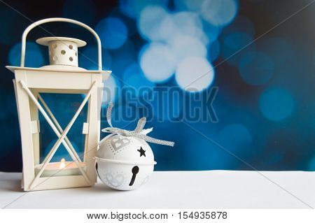 Christmas ball tree and lantern on blue bokeh light background