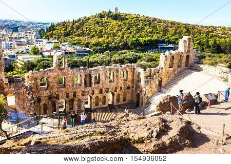 Athens, Greece - October 14, 2016: People near ancient amphitheater of Acropolis of Athens, landmark of Greece
