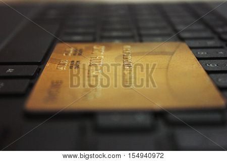 Close-up of credit card on computer keyboard