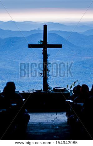 christian worship cross overlooking mountains at sunrise poster