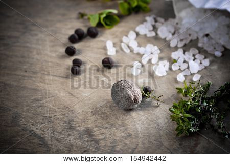 Herbs and seasoning on a wooden table