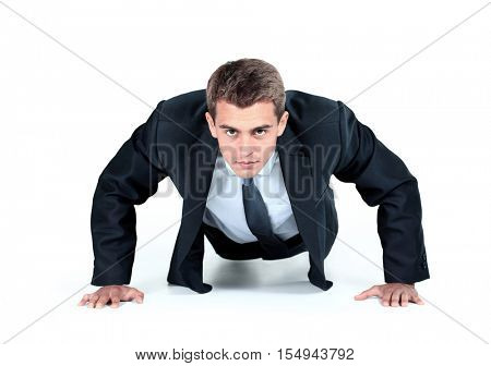 Business man doing push-ups
