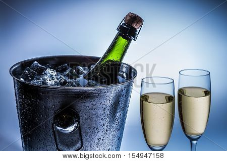 Cold Chilled Champagne In Ice Bucket With Two Glasses