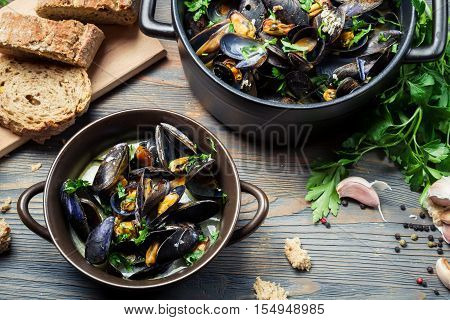 Homemade way of serving mussels on old wooden table