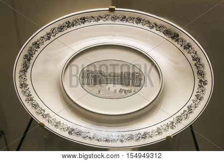 Moscow Russia -September 082016: Table set with views of Paris. Gravy boat with a view of the Louvre and the Porte Saint-Denis. Museum of the Patriotic War of 1812