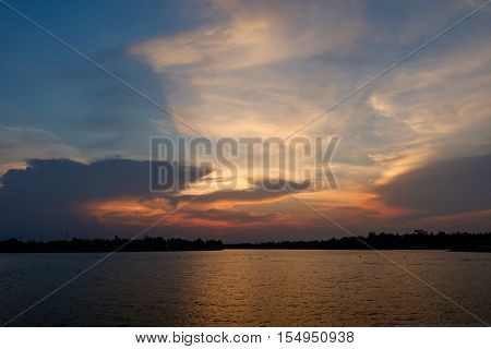 Cloud Shadow, Crepuscular Rays in evening with blue sky and wonderful light at river