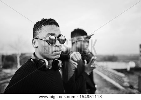 Three Rap Singers Band On The Roof. Black And White Photo