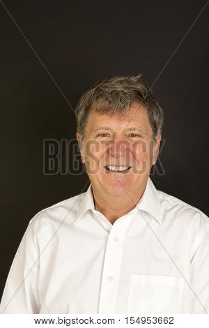 Mature Man In White Business Shirt Laughing