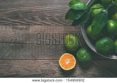 Fresh tangerines on wooden background. Autumn harvest