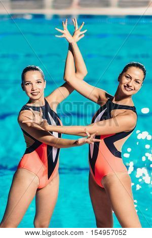 Synchronized Swimmers By The Pool