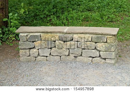 A Stone Constructed Park Bench in the Countryside.