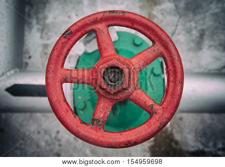top view on old red handwheel of valve