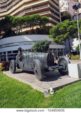 sculpture of race car and driver commemorating Grand Prix Monte Carlo Monaco