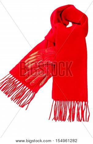 Red scarf out of pure cashmere wool and warm red leather gloves for winter isolated on white background.