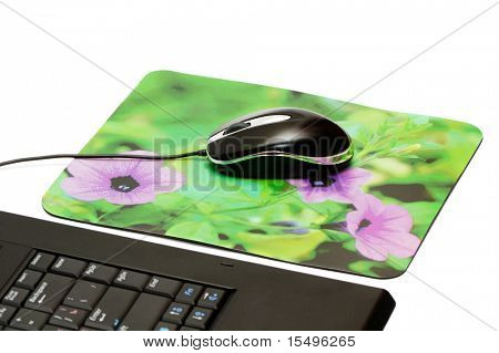 computer mouse and mouse pad isolated on a white background.