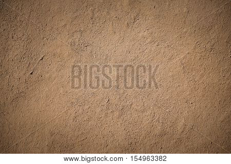 closeup detail of old brown stucco clay wall rough surface background or backdrop in architectural material concept