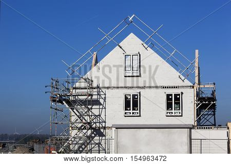 Construction site with houses with prefabricated walls in the Netherlands and a lot of blue sky
