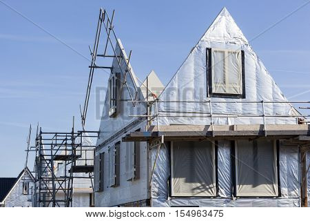 Construction site with houses with prefabricated walls in the Netherlands