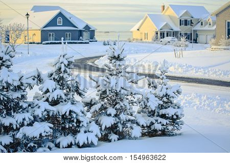Snow covered landscape of an urban neighborhood.
