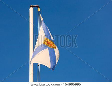 LOWER SELMA - SEPTEMBER 30 2016: Flag of Nova Scotia in light breeze.