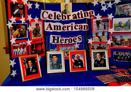 Siler City North Carolina - November 3 2016: Framed photos featuring local members of the military celebrate American heroes at Central Carolina Community College in honour of Veteran's Day