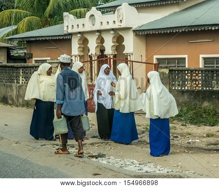 ZANZIBAR, TANZANIYA- JULY 12: town shoolgirls on a street on July 12, 2016 in Zanzibar