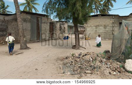 ZANZIBAR, TANZANIYA- JULY 13: african pupils on a village street on July 13, 2016 in Zanzibar